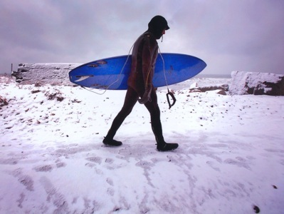 Julien surfing in the winter.  Passionate - or crazy?